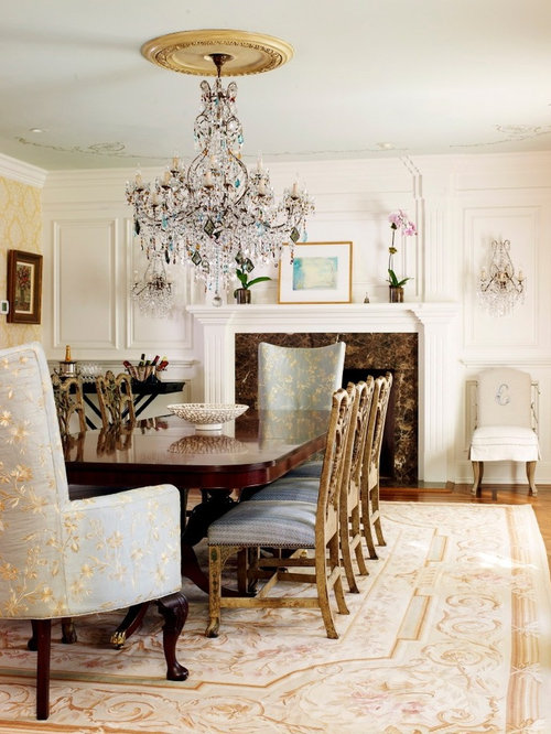 Superb Example Of A Classic Medium Tone Wood Floor Dining Room Design In New York  With White
