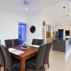Contemporary Dining Room by EDR Building Designs