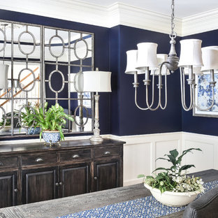 Inspiration for a mid-sized country medium tone wood floor and brown floor enclosed dining room remodel in Atlanta with blue walls
