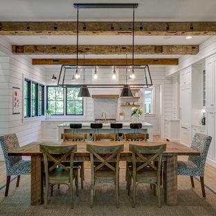 Great room - cottage medium tone wood floor and brown floor great room idea in Other with white walls