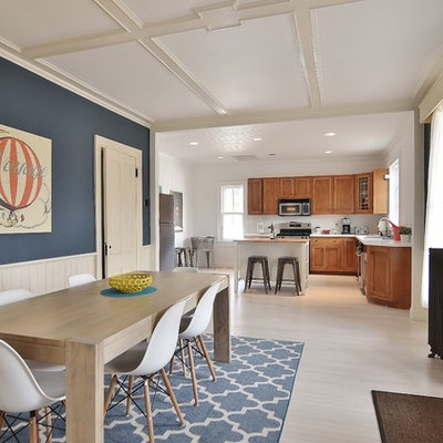 Large danish painted wood floor kitchen/dining room combo photo in New York