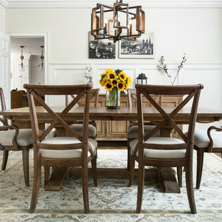 Example of a mid-sized country dark wood floor and brown floor enclosed dining room design in Atlanta with white walls and no fireplace