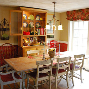 Country medium tone wood floor dining room photo in Boston with yellow walls