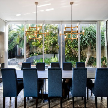 Feature brass pendant lights above dining room