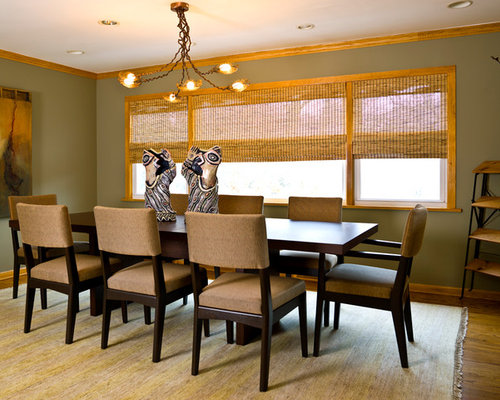 Example Of A Trendy Medium Tone Wood Floor Dining Room Design In Chicago With Green Walls