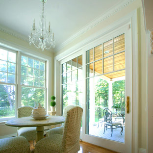 Great room - small traditional medium tone wood floor great room idea in Boston with yellow walls and no fireplace