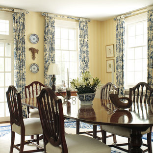 Design ideas for a traditional dining room in Other with yellow walls.