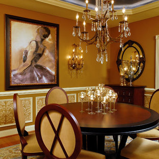 Example of an ornate dark wood floor dining room design in DC Metro with brown walls