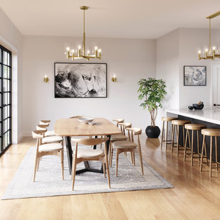 Inspiration for a contemporary light wood floor and beige floor kitchen/dining room combo remodel in Other with white walls and no fireplace