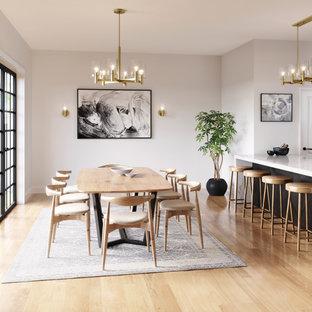 Esempio di una sala da pranzo aperta verso la cucina design con pareti bianche, parquet chiaro, nessun camino e pavimento beige