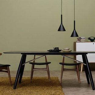 Modelo de comedor escandinavo, abierto, con paredes verdes y suelo de madera clara