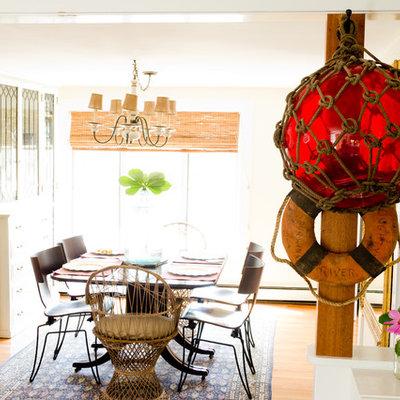 Example of a beach style medium tone wood floor dining room design in Portland Maine