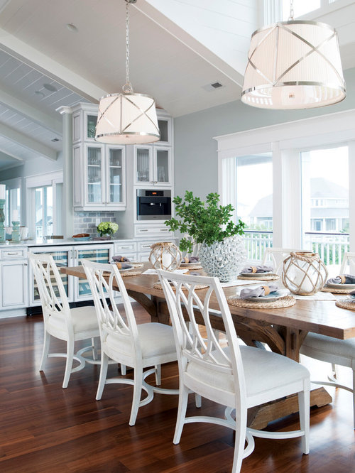 Example of a coastal dark wood floor kitchen dining room combo design in  Wilmington with. Wood Table White Chair   Houzz
