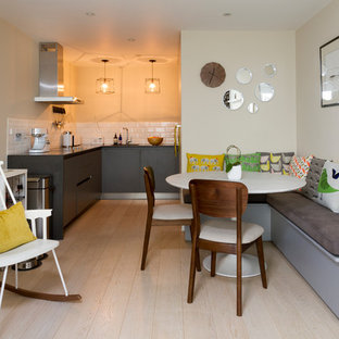 Photo of a small retro open plan dining room in London with no fireplace.