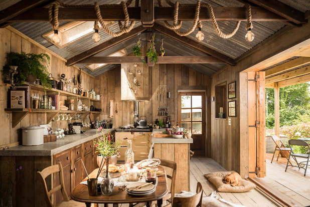 Rustic Dining Room by Unique Home Stays