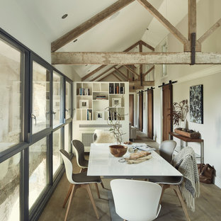 Enclosed dining room - industrial medium tone wood floor and brown floor enclosed dining room idea in Other with gray walls