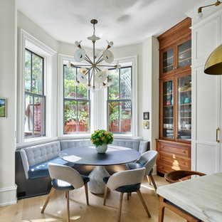 Inspiration for a transitional light wood floor and beige floor breakfast nook remodel in Philadelphia with white walls
