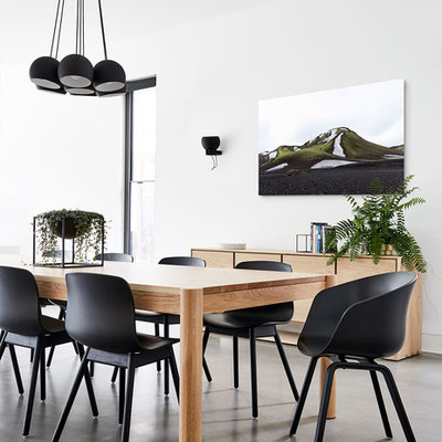 Example of a trendy concrete floor and gray floor enclosed dining room design in Melbourne with white walls