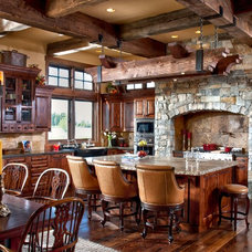 Rustic Dining Room by Montana Build, Inc.