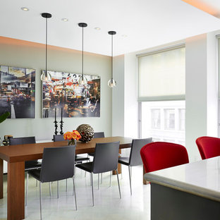 Example of a trendy gray floor kitchen/dining room combo design in New York with gray walls