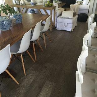 Idee per una sala da pranzo con pavimento in laminato