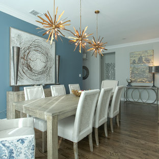 Large transitional dark wood floor and brown floor enclosed dining room photo in Dallas with gray walls
