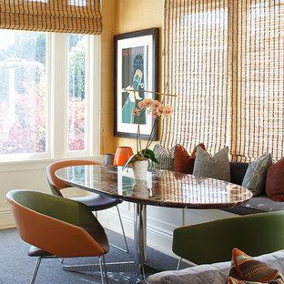Inspiration för mellanstora moderna kök med matplatser, med heltäckningsmatta och gula väggar