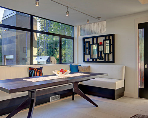 Elegant Contemporary Dining Room Idea In Seattle With White Walls
