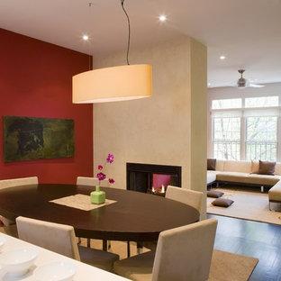 Idee per una sala da pranzo aperta verso il soggiorno minimal con pareti rosse e camino bifacciale