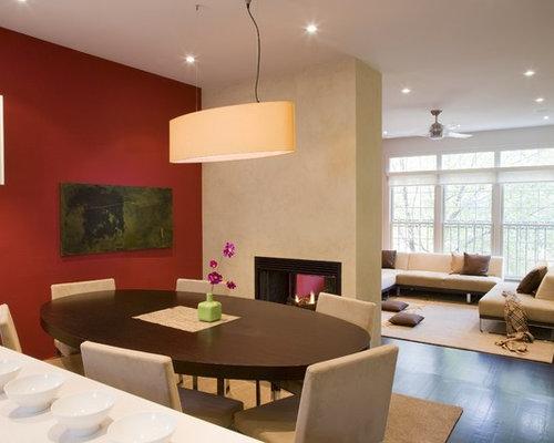 Sala da pranzo aperta verso il soggiorno con pareti rosse - Foto, Idee, Arredamento