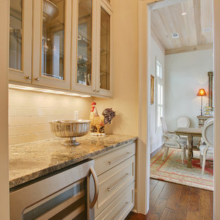 Inspiration for a timeless dark wood floor dining room remodel in New Orleans with beige walls
