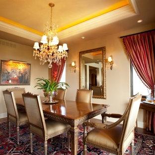 Elegant dark wood floor dining room photo in Denver with beige walls