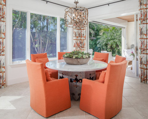 Island Style Gray Floor Enclosed Dining Room Photo In Miami With White Walls