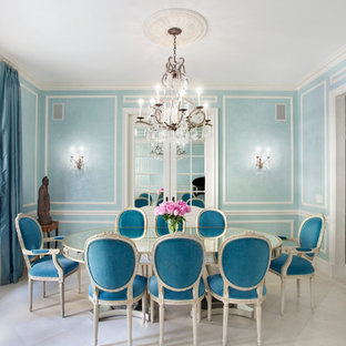 Enclosed dining room - mid-sized victorian limestone floor enclosed dining room idea in New York with blue walls