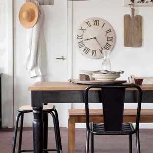 Industrial dining room in Melbourne with white walls.