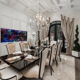 Esempio di un'ampia sala da pranzo shabby-chic style chiusa con pareti bianche, pavimento in legno massello medio, camino classico, cornice del camino in pietra e pavimento marrone