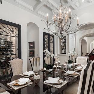 Ispirazione per un'ampia sala da pranzo shabby-chic style chiusa con pareti bianche, pavimento in legno massello medio, camino classico, cornice del camino in pietra e pavimento marrone