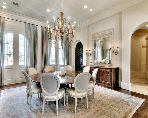 Example Of A Classic Dark Wood Floor Dining Room Design In Houston With  White Walls