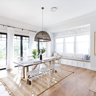 Design ideas for a country open plan dining in Brisbane with white walls, medium hardwood floors and brown floor.