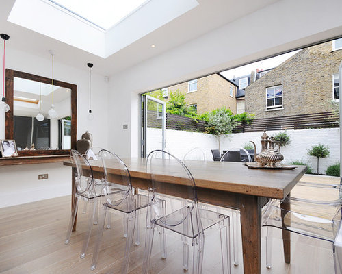 louis ghost chair  Example of a trendy dining room design in London with  white wallsLouis Ghost Chair   Houzz. Ghost Chair Louis. Home Design Ideas