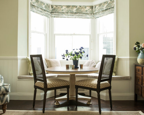 design ideas for a traditional dining room in london with dark hardwood flooring - Traditional Dining Room Ideas