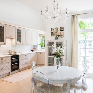 Photo of a medium sized classic kitchen/dining room in London with white walls, light hardwood flooring, no fireplace and beige floors.