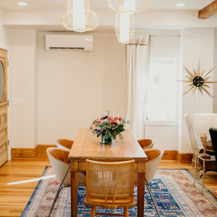 Example of a 1960s light wood floor and beige floor great room design in Other with white walls