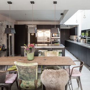 Inspiration for a large eclectic open plan dining in London with white walls and light hardwood floors.