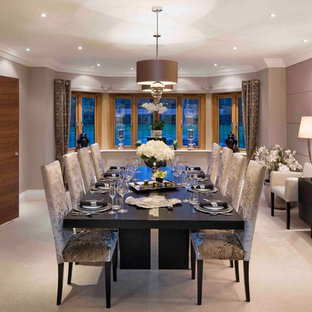 Inspiration for a traditional enclosed dining room in London with beige walls and carpet.
