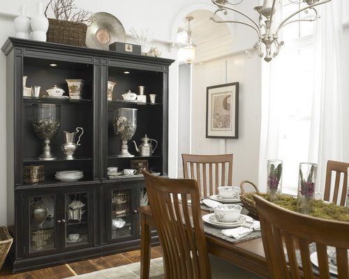 Example Of An Eclectic Dark Wood Floor Dining Room Design In Charlotte With White Walls
