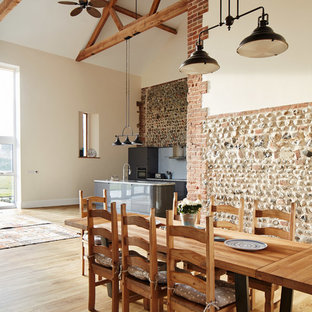 Inspiration for a large farmhouse open plan dining room in Other with white walls, light hardwood flooring and beige floors.