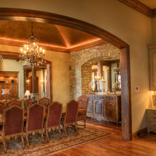 Rustic Dining Room by Gabriel Builders Inc.