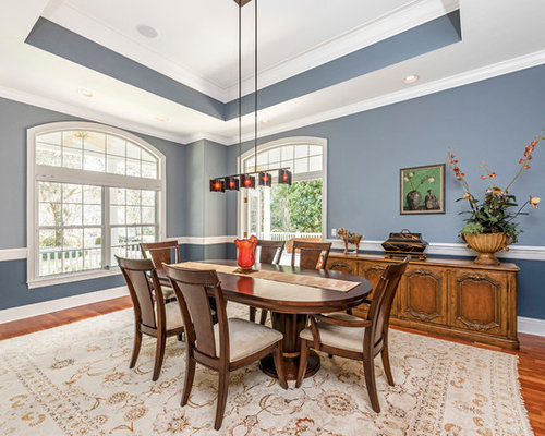 Elegant Medium Tone Wood Floor Enclosed Dining Room Photo In Tampa With Blue Walls