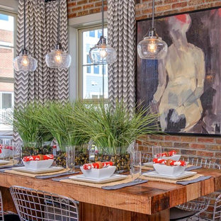 Urban dining room photo in Portland Maine with red walls